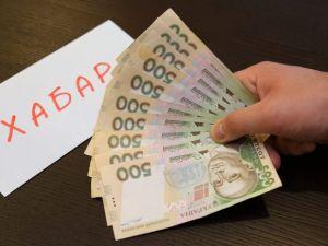 Кіровоградщина: Юрисконсультку підозрюють у вимаганні хабара